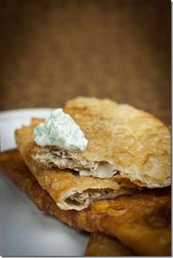 Chebyreki, meat stuffed tortilla, fried to crispy perfection and paired with yogurt+cucumber dip. By LettheBakingBeginBlog.com
