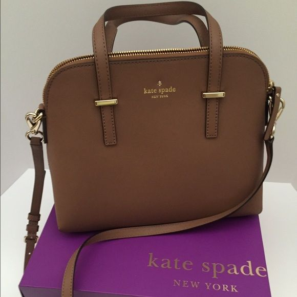 """New Kate Spade New York Cedar St Maise Bag Authentic New without Tags, Kate Spade box and dust bag included.This classy bag is Gingersnap brown leather with 14 karat light gold plated hardware. The satchel is lined in coordinating custom Kate Spade lining and has an inner zipper pocket with 2 open slip pockets. Fully zipped top closure, Kate Spade bow and logo on the front and 4 feet on the bottom for protection. Dual handles with a drop of 4.5"""" and adjustable shoulder or cross body strap…"""