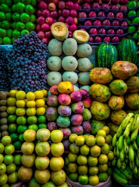 Fruit market in Mumbai, India. The artistic and aesthetic sense of the street vendors is displayed in the arrangements of fruit in their road-side stalls.