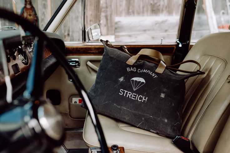 the SOHO bag by STREICH. it is fabricated out of vintage swiss army tent canvas and french army gunbelts. #streichbag #bag #canvasbag #manbag #vintagebag #gunbelt #rollsroyce #silvershadow