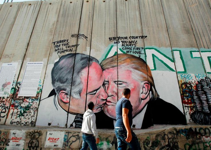 There is a new mural depicting President Donald Trump on the West Bank wall, and this one shows him sharing a romantic moment with Israel's Prime Minis ...