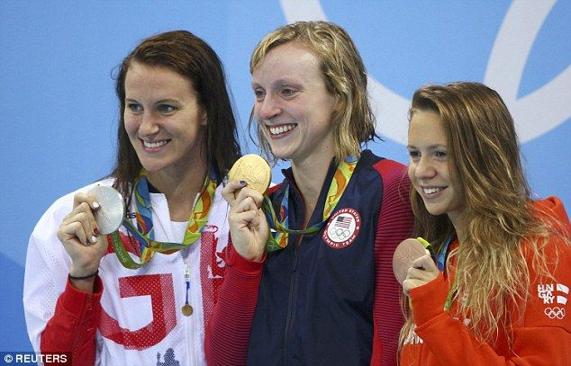 Gold medalist Katie Ledecky of USA poses with silver medalist Jazz Carlin of…