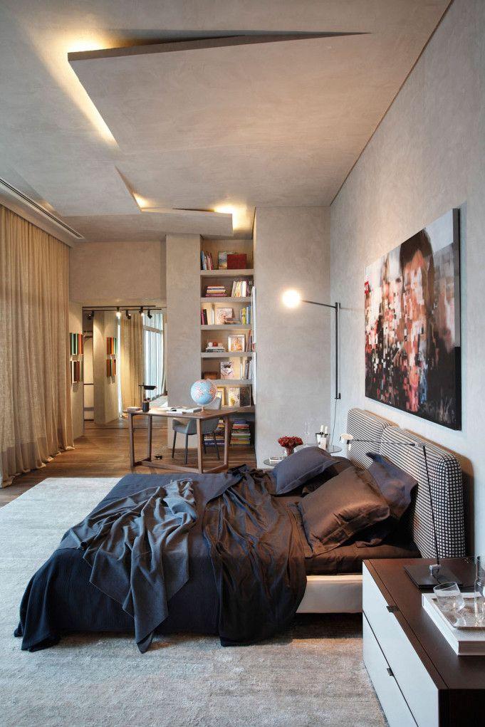 그레이톤의 시크한 침실 인테리어 디자인  그레이톤의 벽과 천장이 시크한 느낌으로 다가오는 인테리어 디자인입니다. 월넛 나무바닥이 차가운 느낌을 중화시키며, 벽과 천장과 같은 색의 카페트가 어우러집니다.  천장에서 뻣어나오는 듯한 느낌의 조명은 상당히 멋집니다. 집 자체가 하나의 갤러리 느낌이 나네요.  침대 벽면에 걸어둔 인물 사진도 모자이크 처리를 하여 작품같은 느낌을 줍니다.    침실 인테리어의 전체적인..
