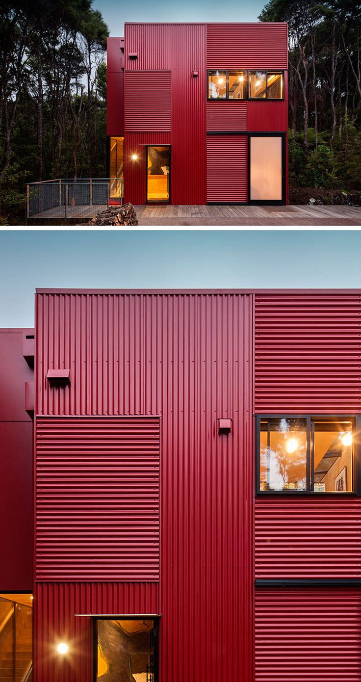 11 Red Houses And Buildings That Aren't Afraid To Make A Statement | Red corrugated metal siding makes this house in the trees pop against the greenery of the forest.