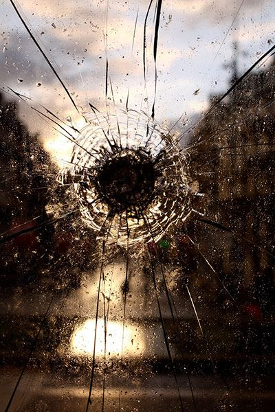 I saw this shattered window at a station in Lille, France, and tried to capture it with the contrast of the setting sun as a background  Photograph: Jessica Hayne