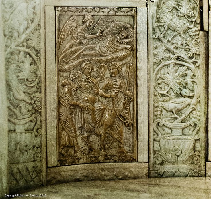 Ivory throne of Bishop Maximian. Angel reassures Joseph and the Journey to Bethlehem. Byzantine, a gift of Emperor Justinian. Ravenna, Italy. 6C.  The angel confirms Mary's story to Joseph in a dream. Matt. i, 20 ff. Museo Arcivescovile. Ravenna, Italy.