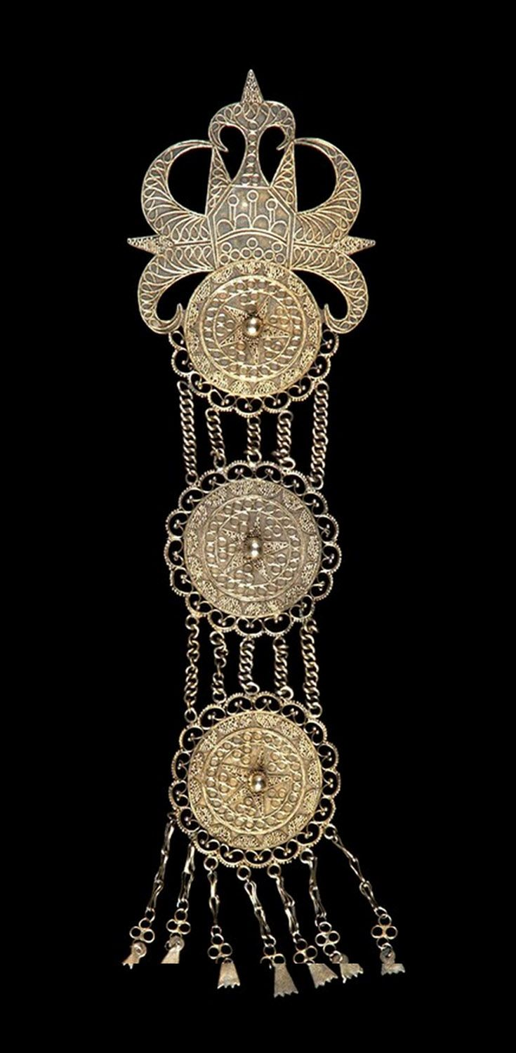 Indonesia - Sumatra | Dress ornament / jacket clip ~ kancing baju ~ from the Batak Karo people; gilded silver, filigree. Worn by young girls on special occasions. 20th century. // ©Quai Branly Museum. 70.2001.27.667