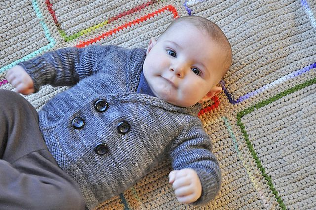 Henry's Sweater is an easy, seamless, top-down cardigan that can be made in one weekend. Size 5 needles are used with worsted weight yarn to help maintain the sweater shape. The double-breasted front and shawl collar will keep your baby comfy and warm!