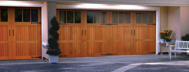 17 best images about wood carriage style garage doors on for Wooden garage door designs