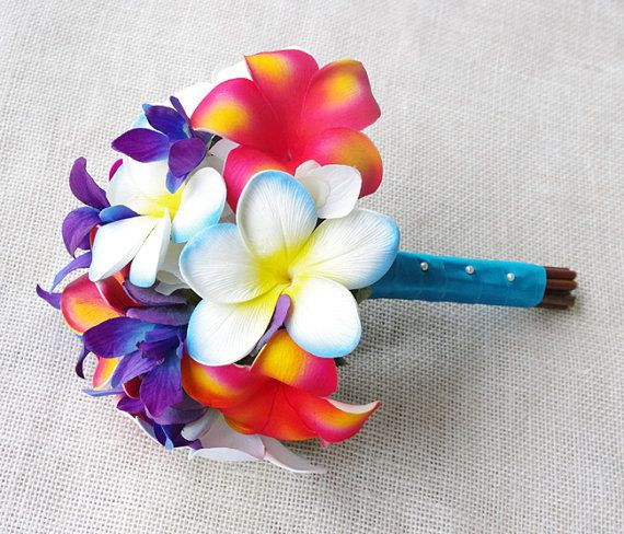 This is a beautiful -almost fresh- Fuchsia, Orange, Blue and Two Tone Purple Plumeria and Orchids Natural Touch Wedding Bouquet.    These flowers are