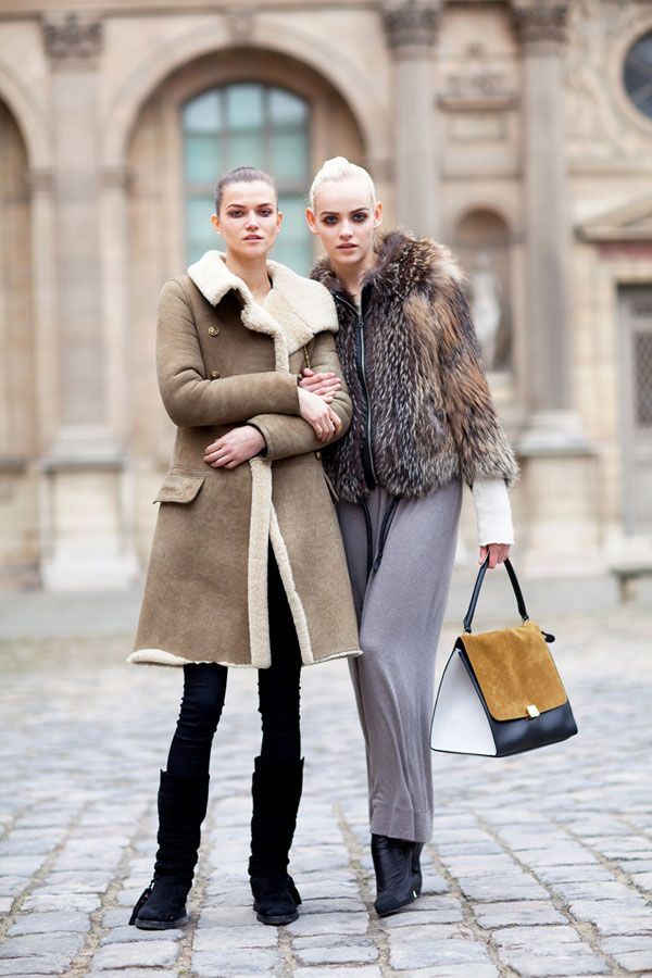 Paris Fashion Week, Fall 2012. Kasia Struss and Ginta Lapina keep it laidback, yet put-together in shearling and fur.