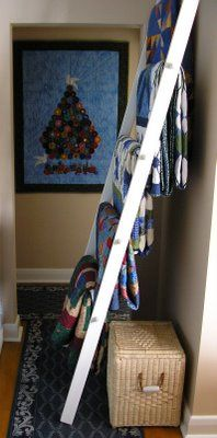 Rose Marie Castonguay's husband made this quilt ladder for her.  Sure wish I had the instructions!