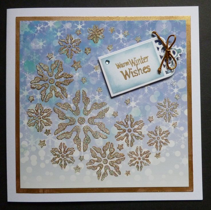 'Warm Winter Wishes' card -  Imagination Craft's - Snowflake crescent stencil.  Blue snow background card.  Diamond Sparkle Medium.  Metal spatula.  Antique gold, Red & Green Starlight paints.  Magi-bond glue.  Spellbinder's tag die.  Faded jeans & Stormy sky Distress inks.   June 2017.   Designed by Jennifer Johnston.