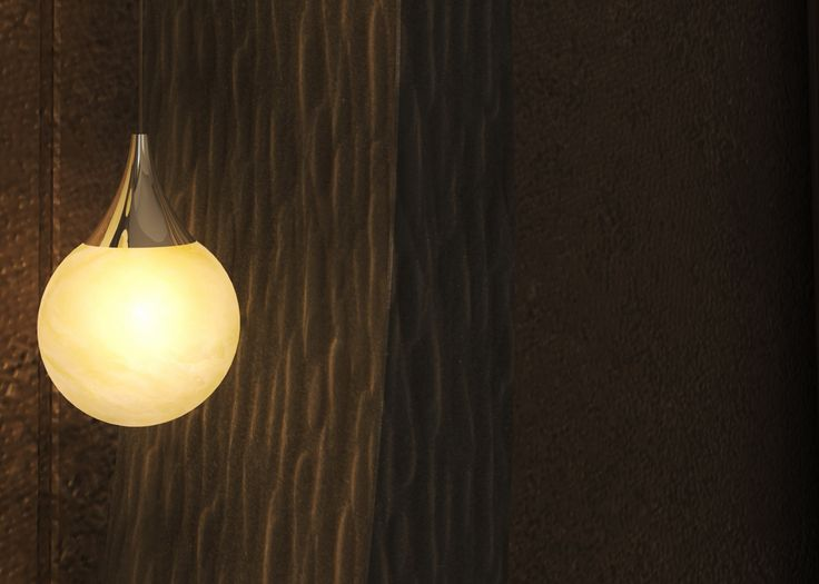 Hand forged floor lamp with hand blown glass. Height: 1,9 meter.