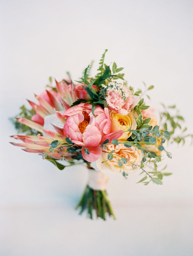 wedding bouquet with pink protea - photo by Jen Rodriguez http://ruffledblog.com/cheerful-san-luis-obispo-wedding