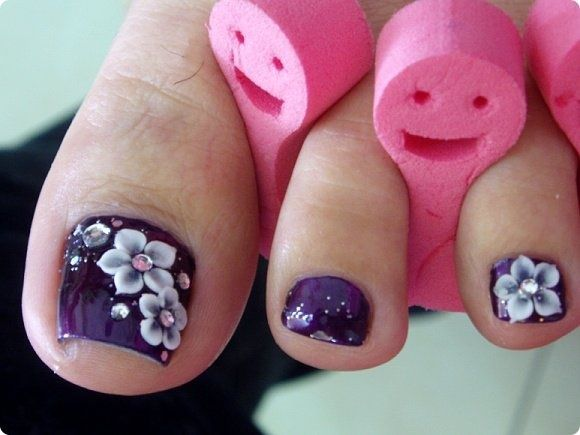 Pretty pedicure: Purple polish, white flower design with pink rhinestone centers, love this!