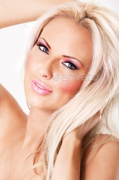 Blonde woman with pink makeup and large lips
