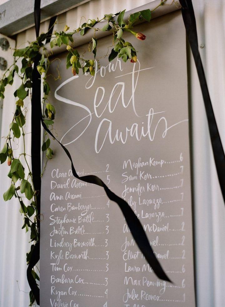 unique wedding reception seating chart idea; Photo: Sylvie Gil