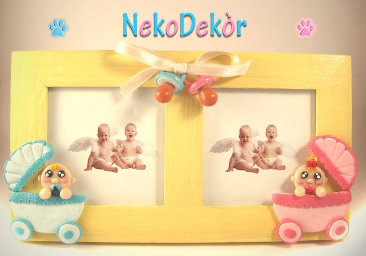 Size:  Width: 18,5 cm / Height: 10,5 cm  Wooden frame with handmade fimo blue and pink baby carriages and pacifiers hold by a satin ribbon.
