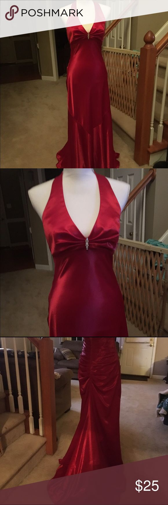 Formal gown This beautiful red gown is perfect for that formal night out, on a cruise or even prom. Perfect condition. No stains, tears or wear. Size 8 Dave & Johnny Dresses Backless