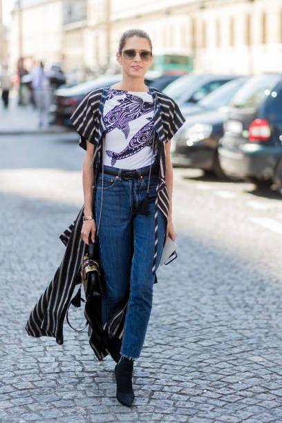 Helena Bordon wearing striped kimono golden Gucci bag cropped denim jeans black shoes outside Ulyana Sergeenko during Paris Fashion Week Haute...