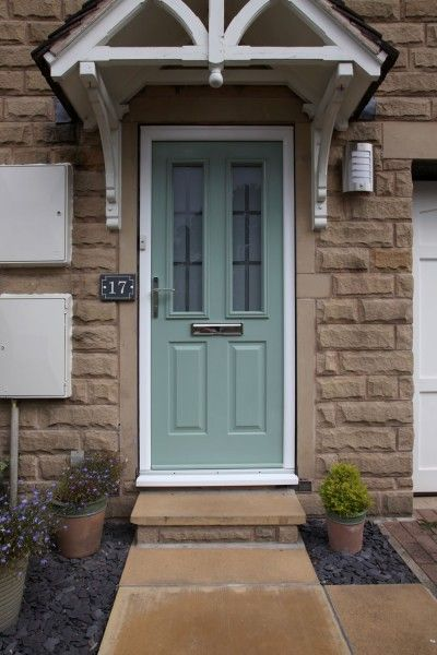 Ludlow composite door in chartwell green with 3D effect glass.