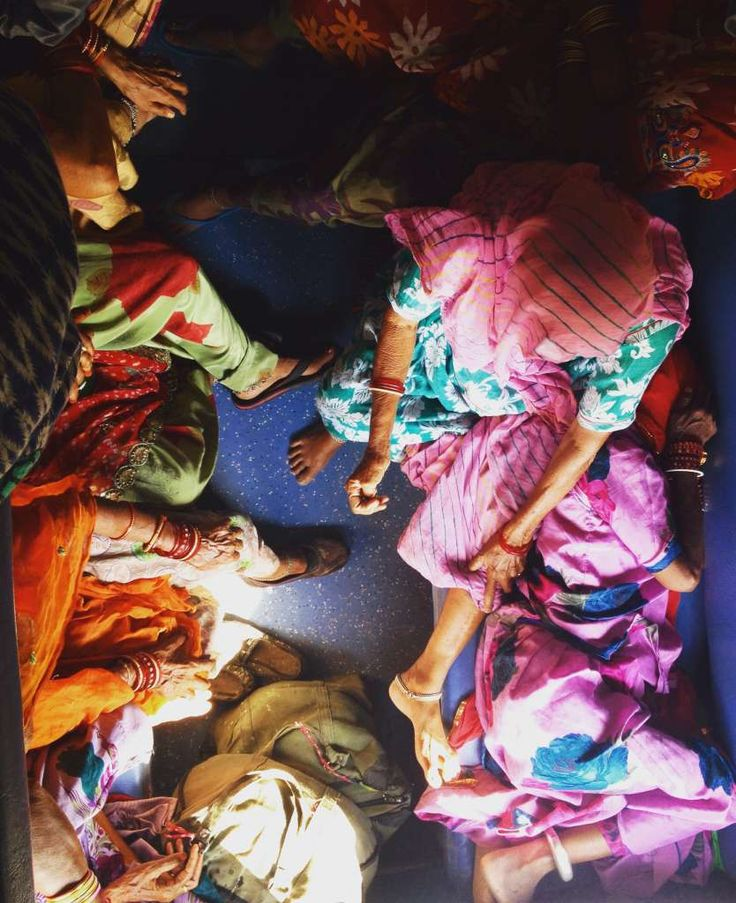 Train travel in india, local women relax on the train