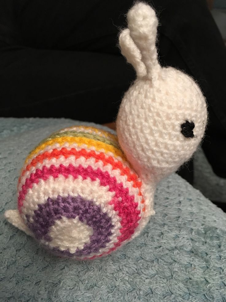 Crocheted snail. Pattern found on Facebook from a Danish source. Pattern translated and worked out by myself! I used variegated ice magic yarn.