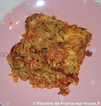 Recette Gratin camarguais .Le gratin camarguais est un plat complet. Le gratin camarguais est composé de riz, courgettes, tomates et de boeuf haché le tout agrémenté de comté râpé et de parmesan. Un vrai plaisir pour les papilles!. Cette recette est une spécialité de la région Provence Alpes Côte d'Azur