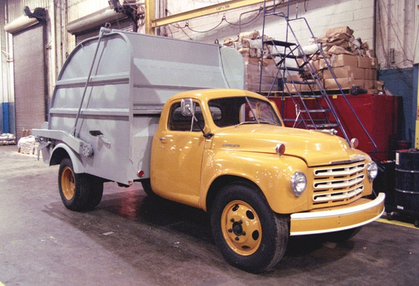 Heil Colecto garbage truck body, on the back of a studebaker chassis