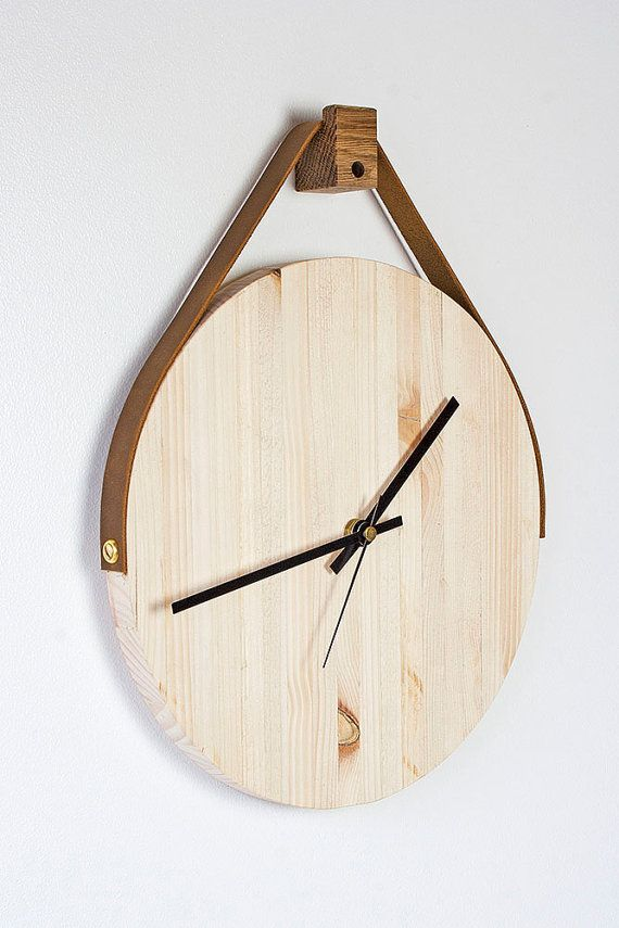 Made from pallets, this rustic colourful wooden wall clock hangs direct from a leather strap, offered in 5 different colours giving your wall a
