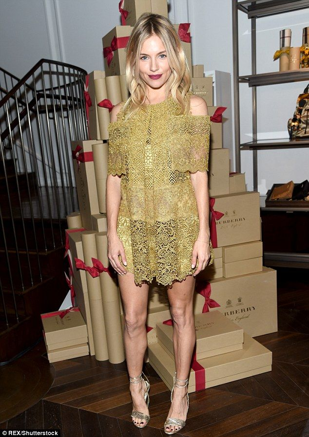 Lovely lady: Sienna Millerlooked absolutely fantastic in a lacy numberas she attended the celebration of The Tale of Thomas Burberry event on Monday night