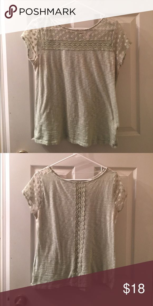 Lauren Conrad olive green short sleeve top. Short sleeve top with see through lace on top and in the sleeves. Cute design on back. In great condition. Only worn a couple of times. LC Lauren Conrad Tops Blouses