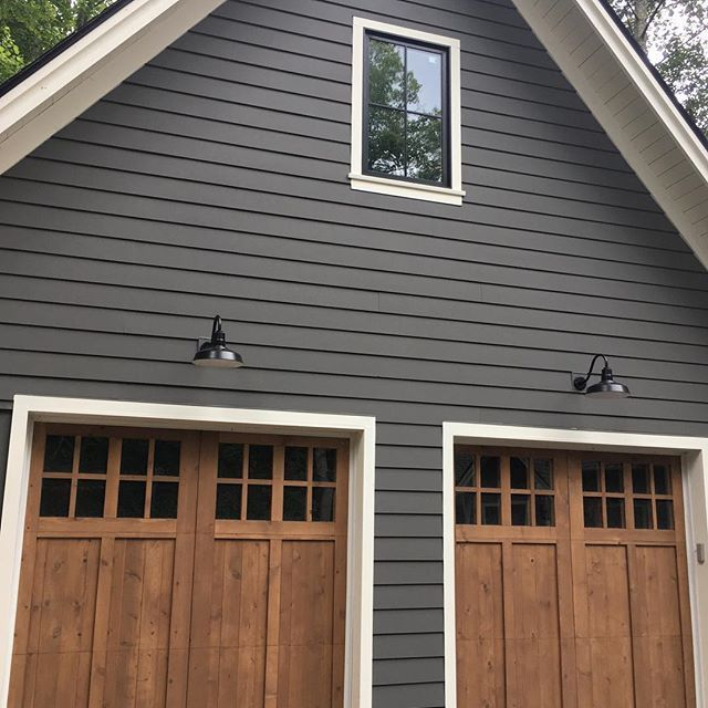 Gray And Natural Wood Accents Exterior Colors Kendall Charcoal By Benjamin Moore Exterior Paint Colors For House House Paint Exterior Exterior House Colors