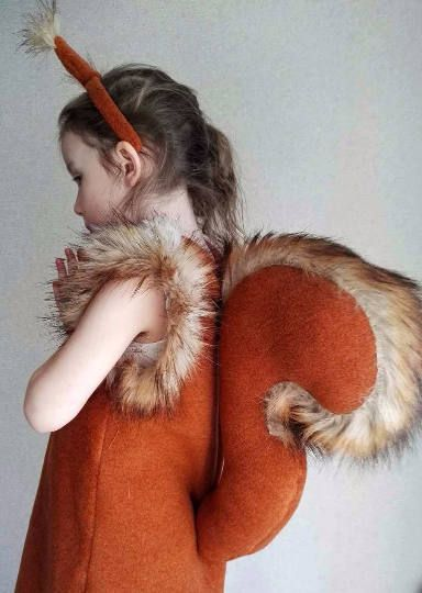 A red squirrel girl costume made of soft fleece and consists of dress, tail, ears headband. Age___Height (in) ___Height (cm) 2 ___ 36 __…