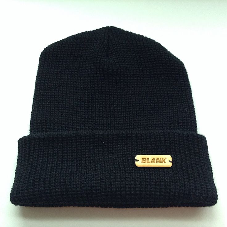 Black cuffed toque with a small wooden hand sown label!
