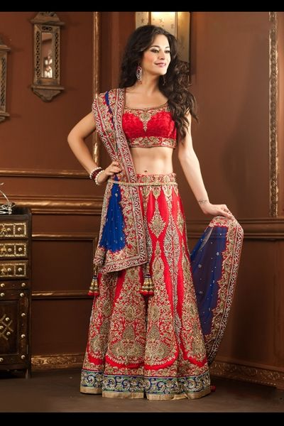 Outstanding red & blue lehenga choli in raw silk material - Welcome to the new age of style in Indian wear by wearing this red & blue color lehenga choli crafted in raw silk material. Lehenga and border of the dupatta are amazingly engraved with katdana and stones work. Choli is prettily designed with thread embroidery in floral pattern and color combination used to design this lehenga choli is awesome.