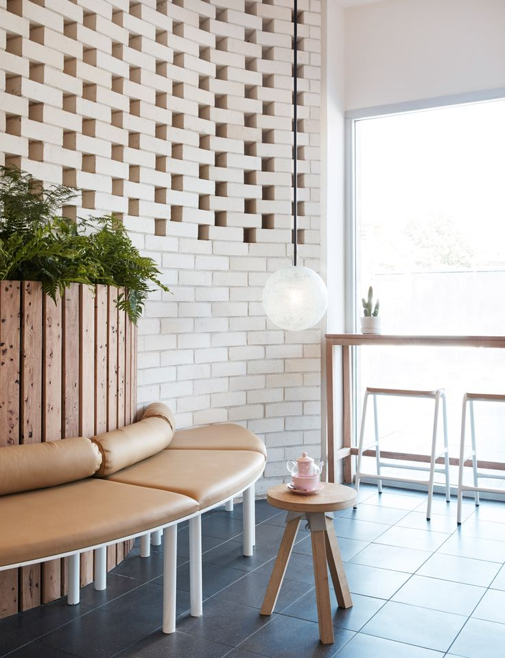 Australian designer Matt Woods has given Chinese cafe chain The Dessert Kitchen a minimal and nature-led interior for its first outpost in Sydney.