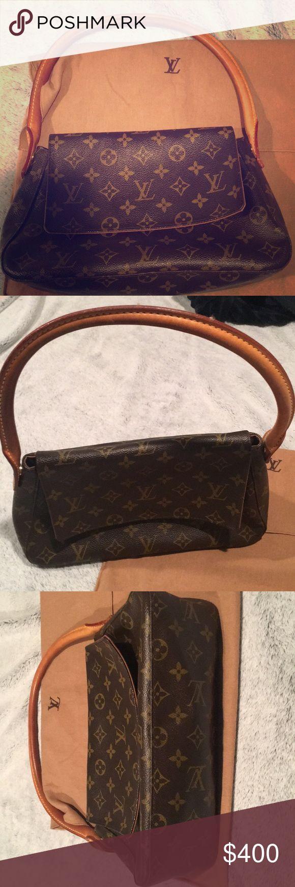 Authentic Louis Vuitton mini loop shoulder bag Excellent condition. Only wear is shown in last photo. Authentic. Louis Vuitton Bags Shoulder Bags