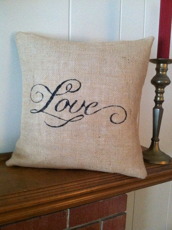 This handmade burlap pillow has the word Love stenciled on it. It is made from natural burlap. This pillow is 14 x 14 and has a envelope closure