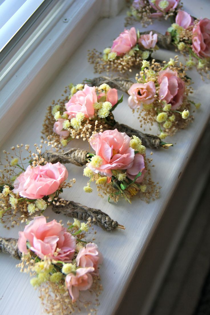 DIY Boutonniere: Bundle the flowers of your choice together, wrap with flower tape, then wrap with material of your choice around it and secure with hot glue.