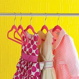 Hot pink children's slim hangers hanging on hang rod