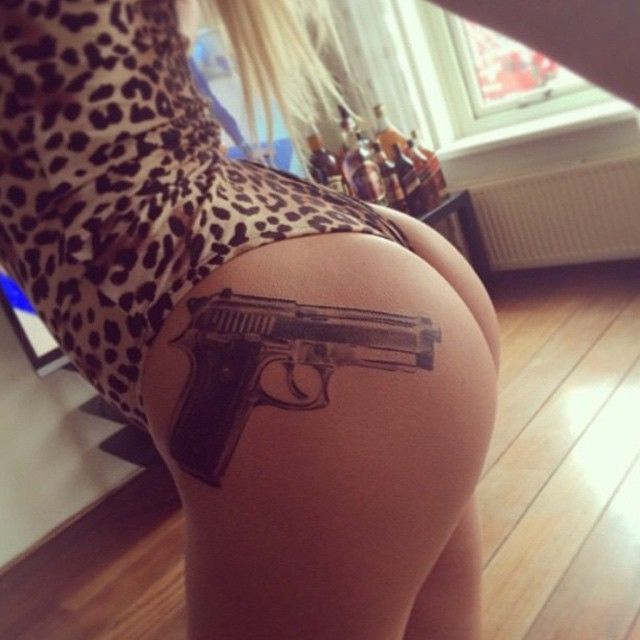 Cute gun tattoo. I've seen one with a gun on a holster.  That would make this even cuter.