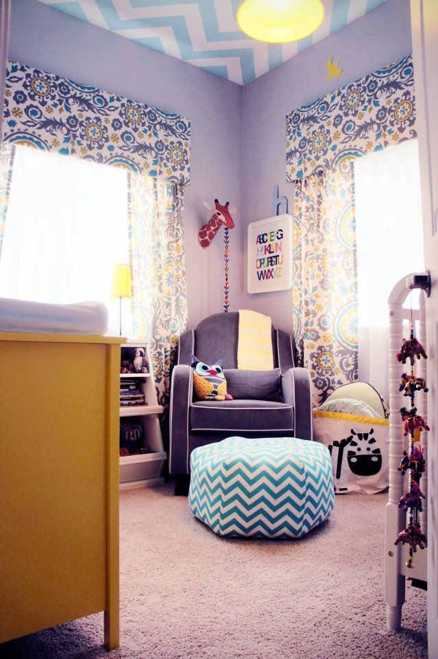 This #chevron ceiling and yellow dresser add fun pops of color to this sweet gender neutral #nursery!