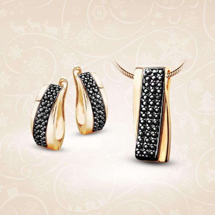 Złoty komplet składający się z kolczyków i zawieszki ozdobione cyrkoniami.  Cena: 664 PLN  http://www.yes.pl/51494-zloty-komplet-KOMPLET-XHC1994-XLC1994