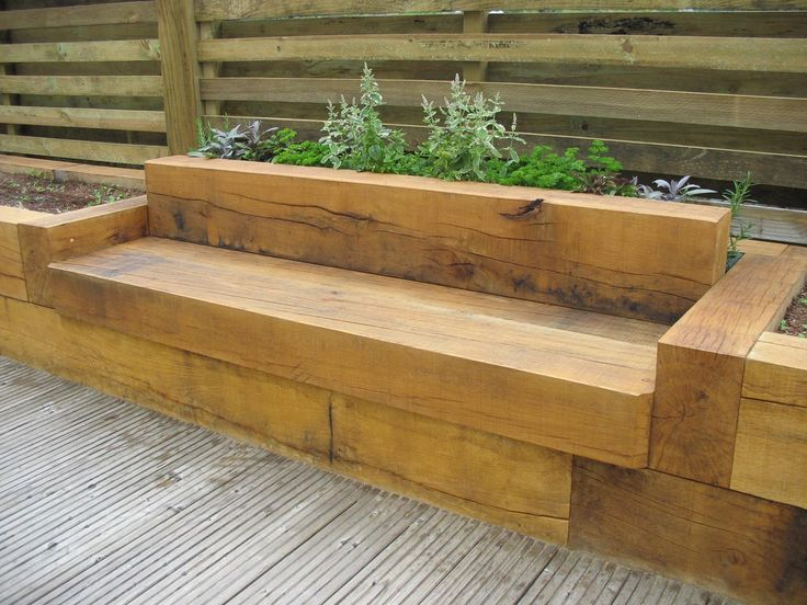 Oak bench with raised flower beds deck designs for Garden decking borders