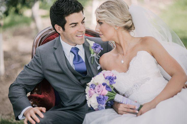 Matt Shumate Photography backyard wedding bride and groom portrait sitting in red velvet chaise lounge purple gray pink