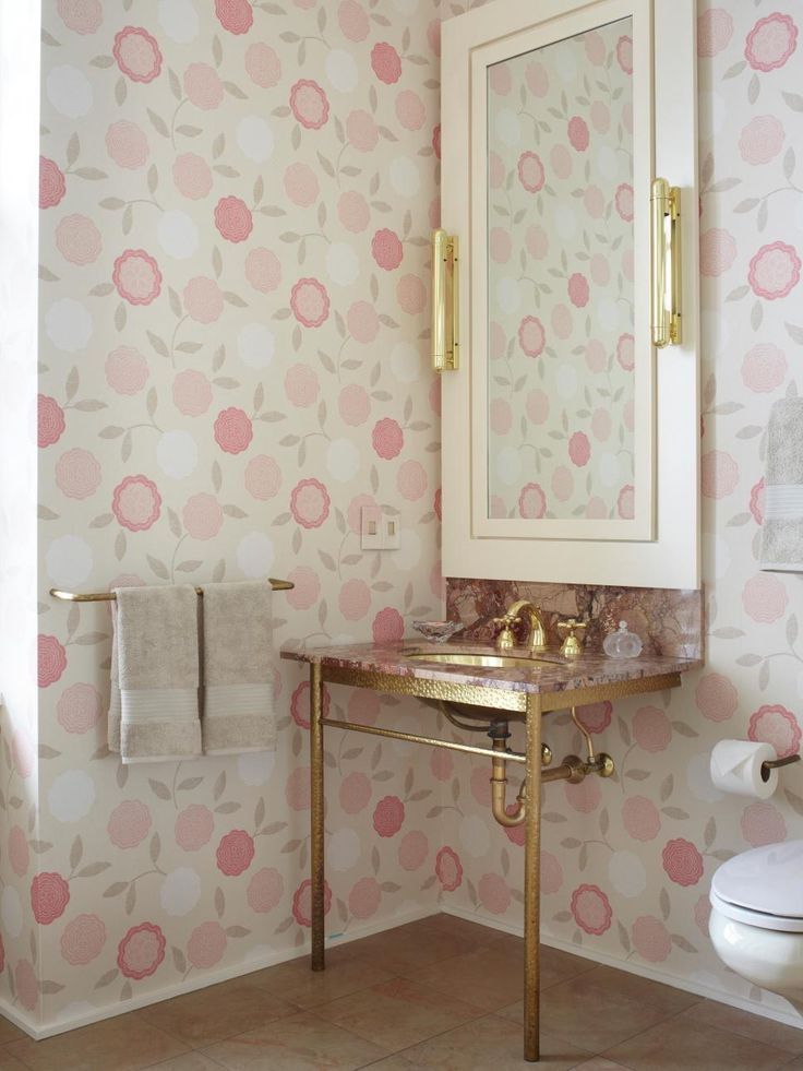 Unique Bathroom Decor   The Gold Accents And The Modern Floral Wallpaper  Give This Pink Powder Room An Unexpected Touch Of Glamour.