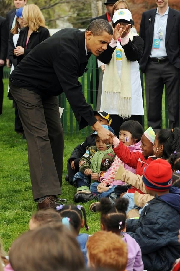 President Barack Obama greets children at the annual White House Easter Egg Roll on the South Lawn of the White House April 13, 2009 in Washington, DC. The event dates back to 1878 and is named for races where children push colored eggs across the grass using wooden spoons.