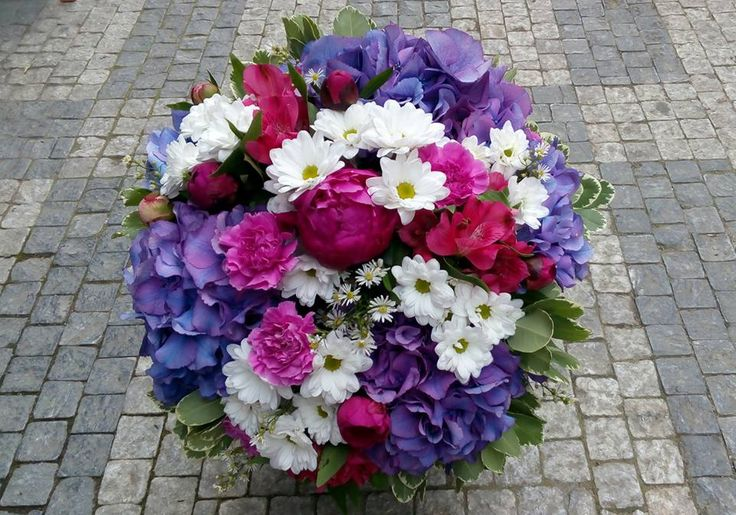 A big bouquet of purple hydrangea, fuchsia peonies, pink carnation, white chrysanthemum